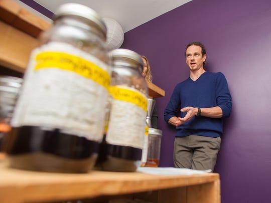 Urban Moonshine chief hebalist Guido Masé discusses FDA requirements last mongth at the Urban Moonshine facility in Burlington. .