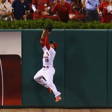 Jon Jay #19 of the St. Louis Cardinals makes a run-saving catch against the Cincinnati Reds in the second inning at Busch Stadium on September 19, 2014 in St. Louis, Missouri.