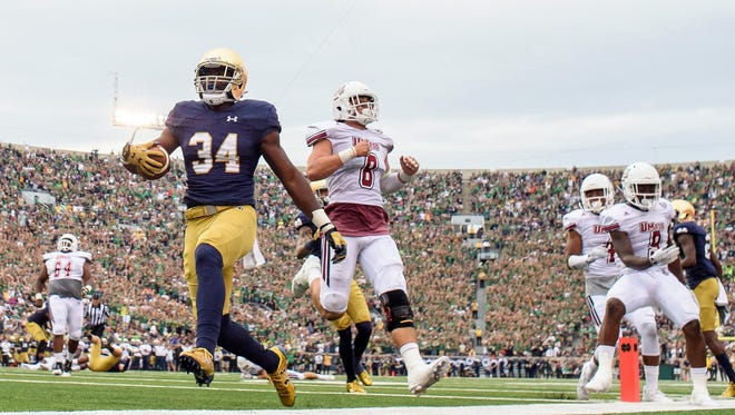 Notre Dame running back Dexter Williams runs in for the touchdown against UMass.