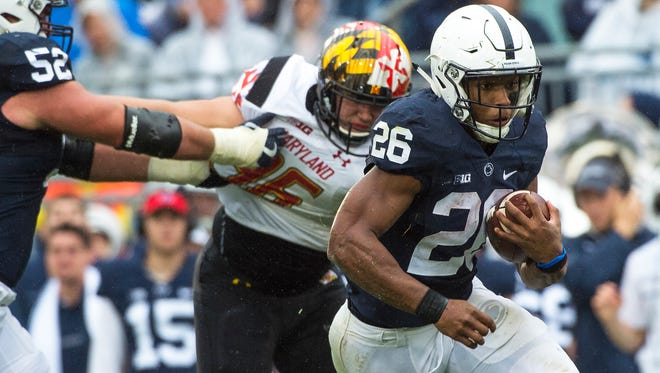 Penn States Saquon Barkley (26) rushes the ball during the second half of a NCAA Division I college football game against Maryland on Saturday, Oct. 8, 2016, at Beaver Stadium. Penn State defeated Maryland 38-14.