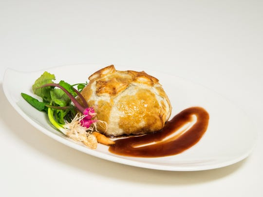 Course: Classic beef Wellington (shown here with the beef encased in its pastry crust). Pairing: Peter Michael Les Pavots cabernet sauvignon blend.