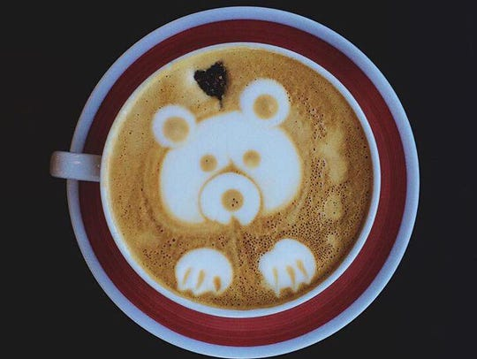 "A latte called ""The Smokey Bear"" with local honey,"