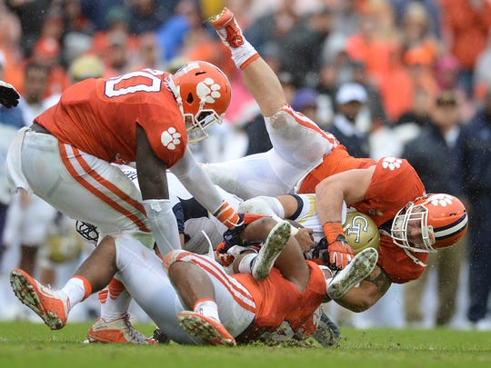 Clemson linebacker Ben Boulware (10) and linebacker B.J. Goodson (44) bring down Georgia Tech quarterback Justin Thomas (5) during the 2nd quarter Saturday, October 10, 2015 at Clemson's Memorial Stadium. Also in on the play is Clemson defensive end Shaq Lawson (90).
