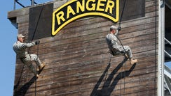U.S. Army Rangers repel from a tower during a demonstration