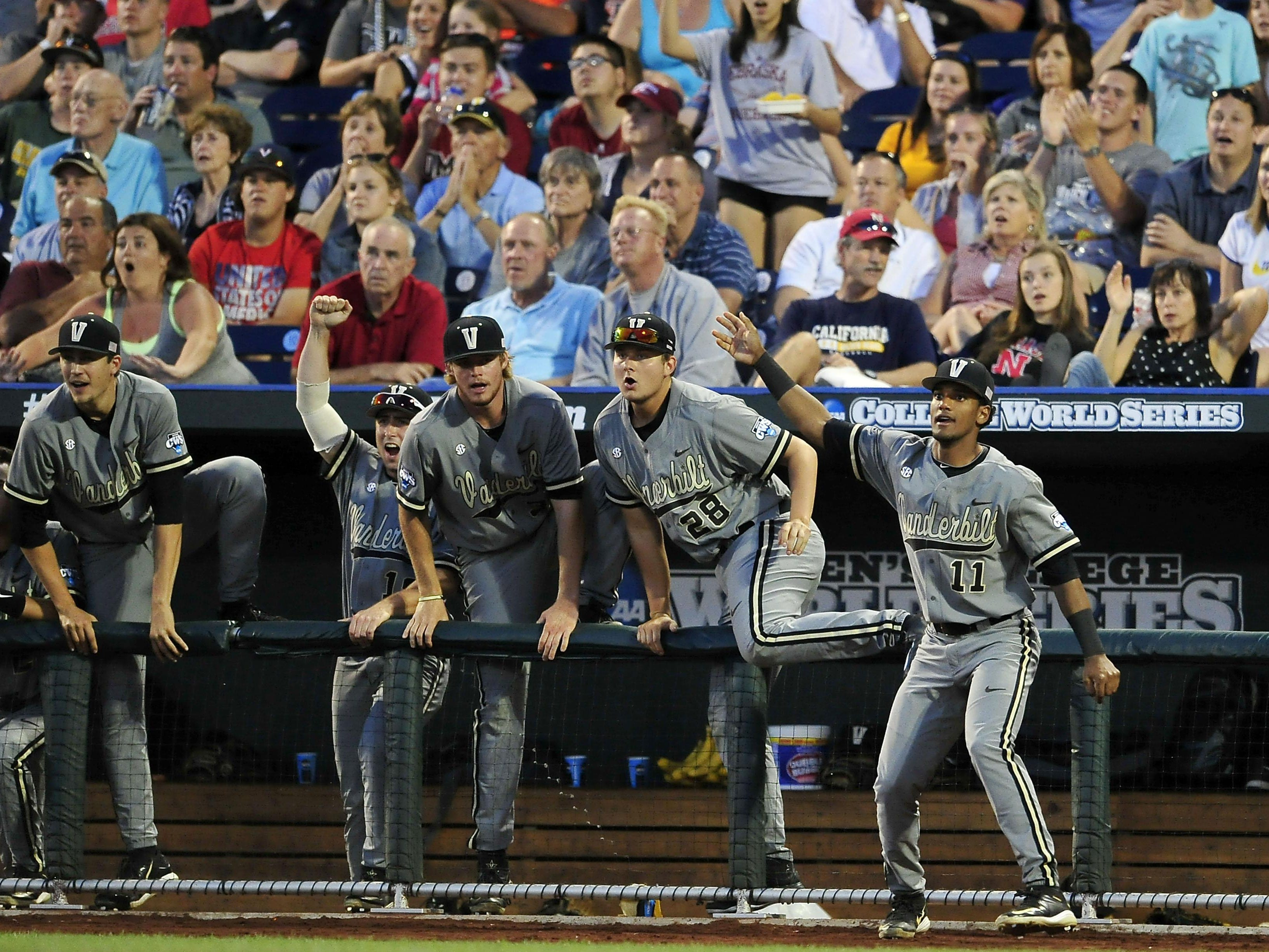 Vanderbilt players including Liam Sabino (11) and Matt Ruppenthal (28) react to Zander Wiel's solo home run against TCU during the seventh inning of the College World Series at TD Ameritrade Park on Tuesday in Omaha, Neb. It was the Commodores' fifth straight one-run win in the College World Series.