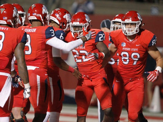 Fresno State's running back Jordan Mims (22) celebrates a touchdown with KeeSean Johnson (3) against BYU during the second half of an NCAA college football game in Fresno, Calif., Saturday, Nov. 4, 2017. Fresno State won the game 20-13. (AP Photo/Gary Kazanjian)