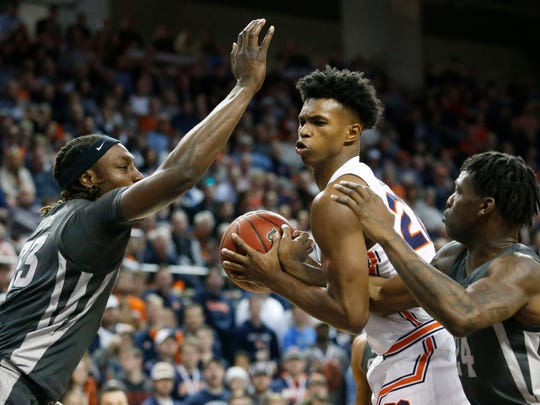 Jan 25, 2020; Auburn, Alabama, USA; Auburn Tigers guard Allen Flanigan (22) wrestles for a rebound with Iowa State Cyclones guard Terrence Lewis (24) and forward Solomon Young (33) during the second half at Auburn Arena. Mandatory Credit: John Reed-USA TODAY Sports