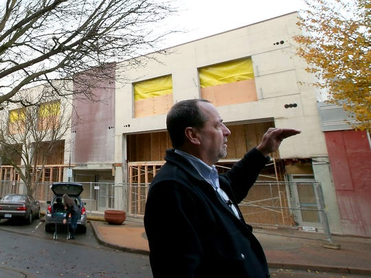 Sound West Group's Mike Brown talks Friday about the work being done to the Sears and Weir buildings on Fourth Street in downtown Bremerton.