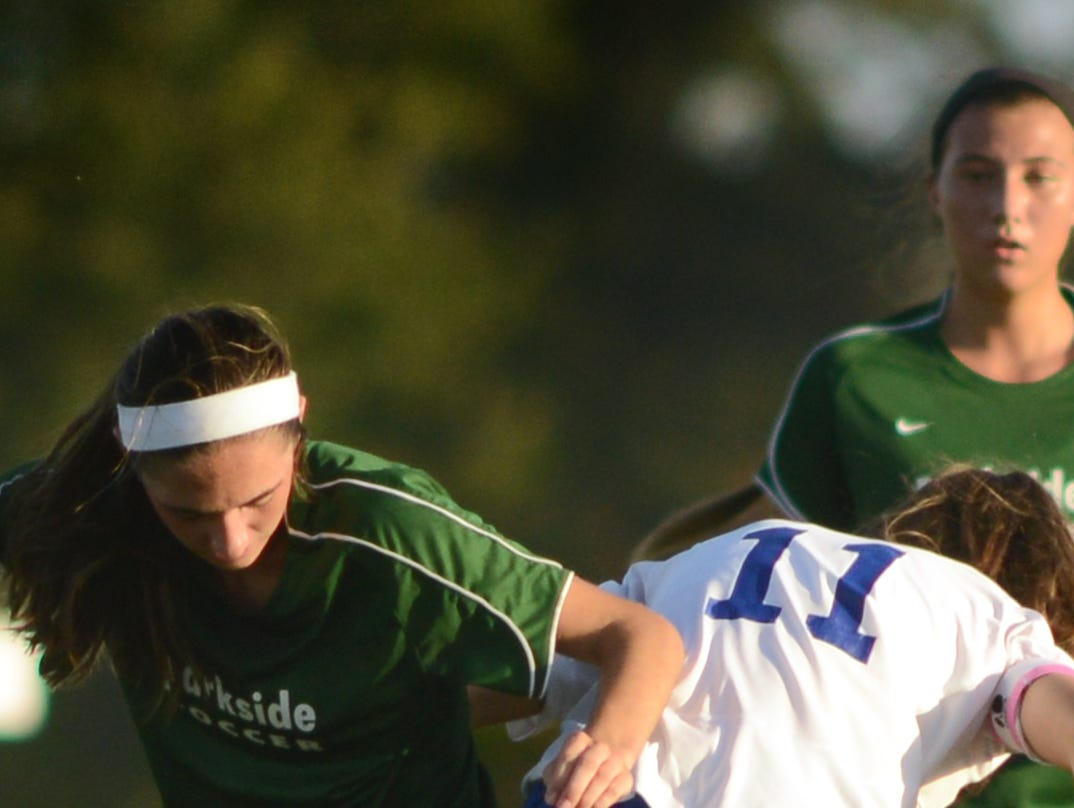 Parkside's Blair Vilov, left, gets tangled up with Decatur's Ally Beck during play Tuesday afternoon at Decatur.