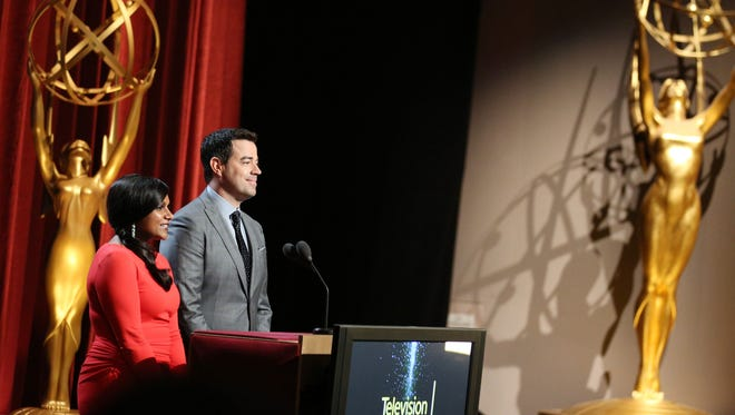 Actress Mindy Kaling and TV host Carson Daly announce the award nominees at the 66th Primetime Emmy Nominations Announcement on Thursday, July 10, 2014, at the Leonard H. Goldenson Theater in the NoHo Arts District in Los Angeles.