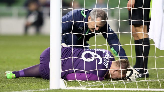 Ireland goalkeeper Rob Elliot lies on the pitch after injuring his knee during the international friendly football match against Slovakia at Aviva Stadium in Dublin.