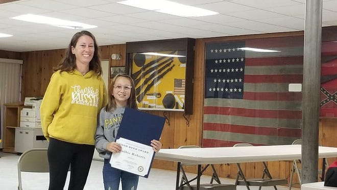 Lena student Colbie Roberts was recently presented with a National Good Deed Award by the Lena American Legion Auxiliary. Pictured, from left: Stacie and Colbie Roberts.
