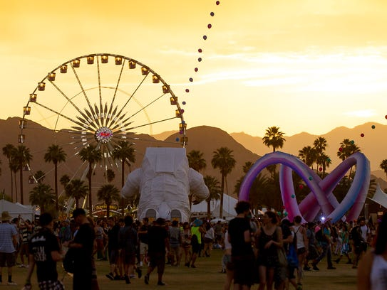 The ferris wheel is photographed during sunset at Coachella