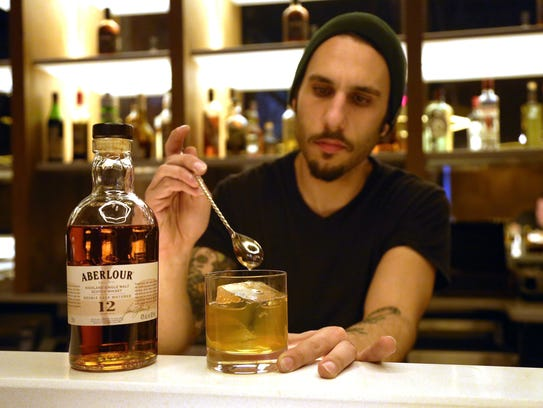 Bad Luck bar manager and partner Yani Frye, 28, prepares