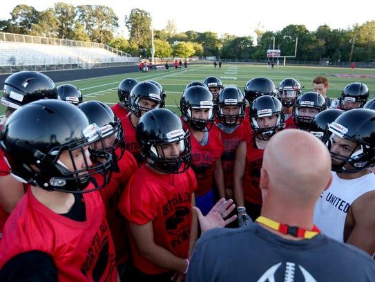 The North Salem High School football team practices