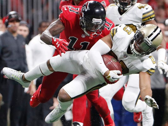 FILE - In this Thursday, Dec. 7, 2017 file photo, New Orleans Saints cornerback Marshon Lattimore (23) runs back an interception as Atlanta Falcons wide receiver Julio Jones (11) makes the tackle tries to make the tackle during the first half of an NFL football game in Atlanta. Four rookies were chosen in voting by NFL players, coaches and fans: running backs Alvin Kamara of the Saints and Kareem Hunt of the Chiefs, cornerback Marshon Lattimore of the Saints, and safety Budda Baker of the Cardinals. Twenty-four of the 86 Pro Bowl selections announced Tuesday, Dec. 19, 2017 are newcomers.(AP Photo/David Goldman, File)