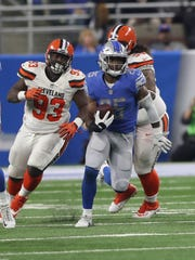 Detroit Lions' Theo Riddick runs the ball against the