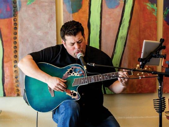 Singer/Songwriter David Neira of Waukesha performs