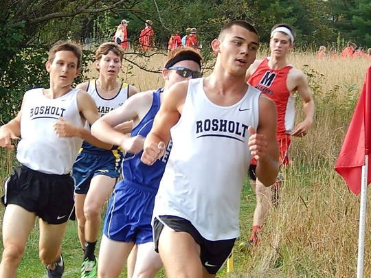 Rosholt's Adam Rzentkowski (front) looks to claim a individual gold medal while also helping his team to a first place finish in the Division 3 boys race.