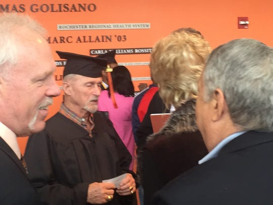 Bob Fitch celebrates his graduation from RIT; he first