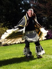 Salem native John Beard models the first Ravenstail robe, the Oregon Swift Robe, that he completed on his own. Beard, a retired pharmacist, has been giving weaving demonstrations at the Oregon State Fair for 32 years. He will demonstrate Ravenstail weaving at this year's fair Aug. 28-30 in Columbia Hall.