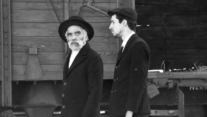 "Iván Angelus, left, and Marcell Nagy play two Jews who startle a small village in post World War II Hungary in ""1945."""