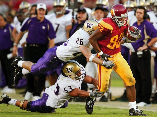 Jimmy Newell (top left, assisting in a tackle) was Rick Neuheisel's first recruit at Washington.
