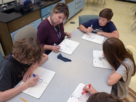 Brentwood Middle School math teacher Holly Jones works on Algebra  with 7th-grade students during focus class on Oct. 19, 2016. The school has won two Blue Ribbon titles in 10 years.