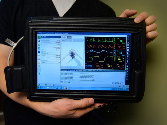 Simulation Technologist Adam Schulz shows that Victoria's functions can be monitored and controlled from a Windows Surface computer.