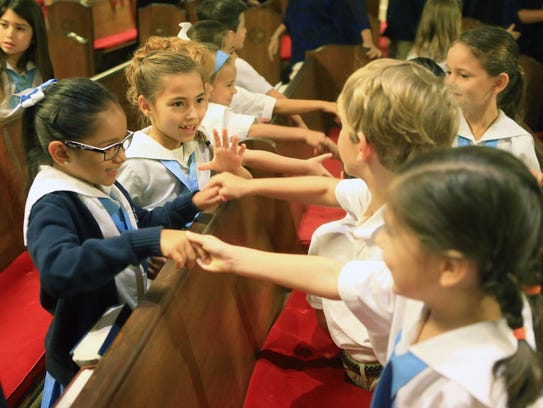 Students from St. James Episcopal School greet each