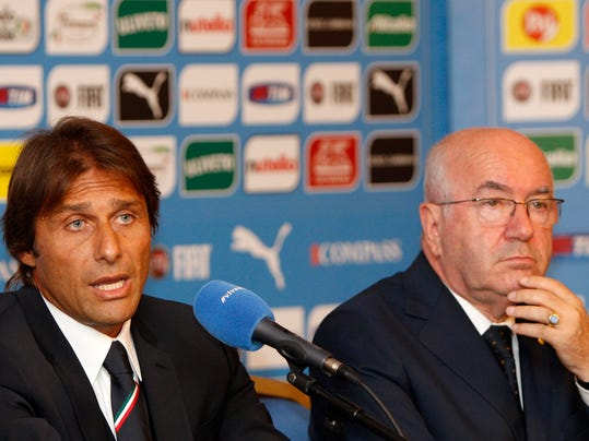 Italian national soccer team's new coach Antonio Conte, left, flanked by Italian Soccer Federation (FIGC) President Carlo Tavecchio, speak during a press conference for his presentation, in Rome, Tuesday, Aug. 19, 2014. (AP Photo/Riccardo De Luca)