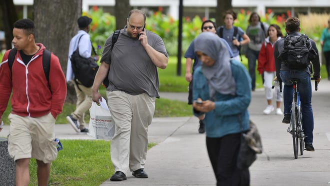 The sidewalks on the St. Cloud State University campus are again a bustling hub of activity as the school's more than 15,000 undergraduate students resumed classes on Monday for the first day of fall semester.