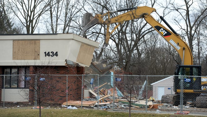 Demolition continues Friday, Feb. 26, 2016 of the former Reid Health Pediatric and Internal Medicine Center at 1434 Chester Boulevard in Richmond. After the rubble is cleared construction will begin on a new medical complex to house Reid ENT, Hearing Center and Allergy Clinic.
