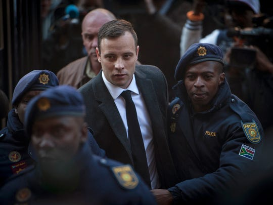 "FILE - In this July 6 2016 file photo Oscar Pistorius, center, arrives at the High Court in Pretoria, South Africa where he was sentenced to six years for the the killing of his girlfriend Reeve Steenkamp. The National Prosecuting Authority says it is going to appeal the jail sentence, stating that it was ""shockingly too lenient."""