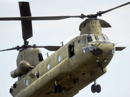 A CH-47 Chinook military helicopter lands at Gilbert Airport in West Manchester Township on Friday. The helicopter was a part of a training session with the Pennsylvania Helicopter Aquatic Rescue Team.