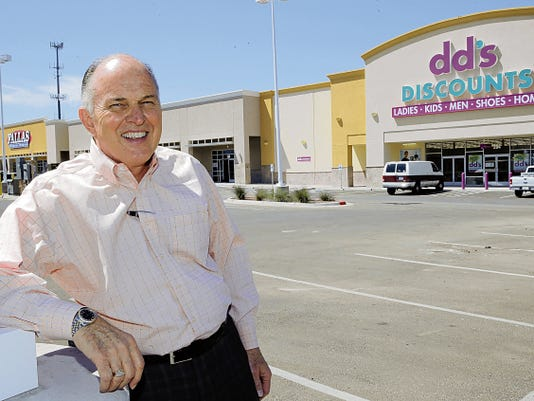 Bob Ayoub, president of Mimco Inc., poses for a photograph in  the parking lot of the Paseo del Norte Plaza, one of the company's newest shopping centers in West El Paso.