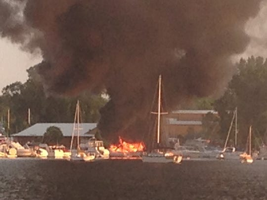 Three boats were engulfed in flames at the Quarterdeck Marina in Sturgeon Bay on Monday evening.