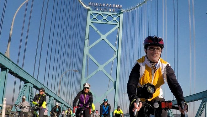 Cyclists ride their bikes across the Ambassador Bridge into Windsor, Canada, Sunday, Oct. 11, 2015.