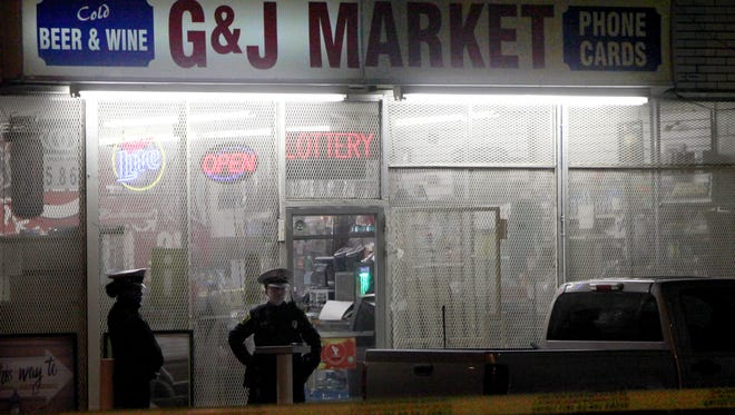Police investigate a shooting in East Price Hill involving a store clerk, who officials said, shot an armed robber as he fled the store Sunday night.