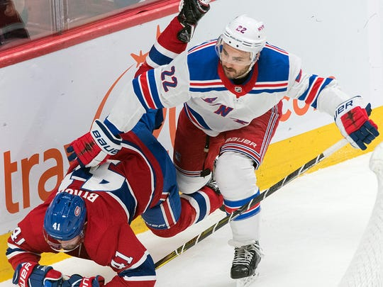 Montreal Canadiens' Paul Byron (41) is upended by New York Rangers' Kevin Shattenkirk during the first period of an NHL hockey game, Saturday, Dec. 1, 2018, in Montreal. (Graham Hughes/The Canadian Press via AP)