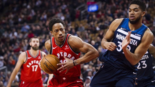 Toronto Raptors guard DeMar DeRozan (10) moves in on Minnesota Timberwolves Karl-Anthony Towns, right, during the first half of an NBA basketball game, Tuesday, Jan. 30, 2018 in Toronto. (Christopher Katsarov/The Canadian Press via AP)