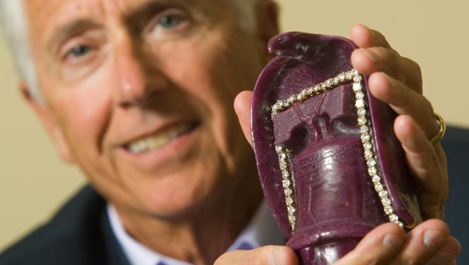 Jim Stein with the Liberty Bell Ruby, a $2 million stone carved into the shape of an eagle wrapped over the Liberty Bell, complete with the bell's crack and studded with diamonds, in 2010.