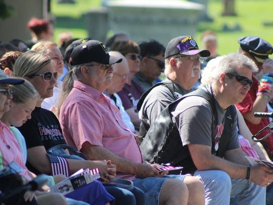 Local veterans listen to a speech given by Lt. Col.