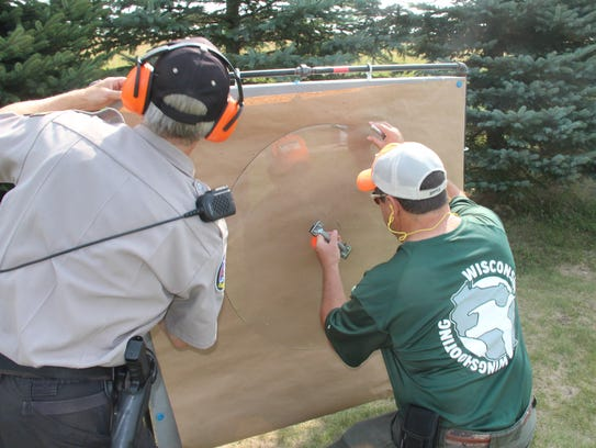 Instructors at a Wisconsin Wingshooting program measure
