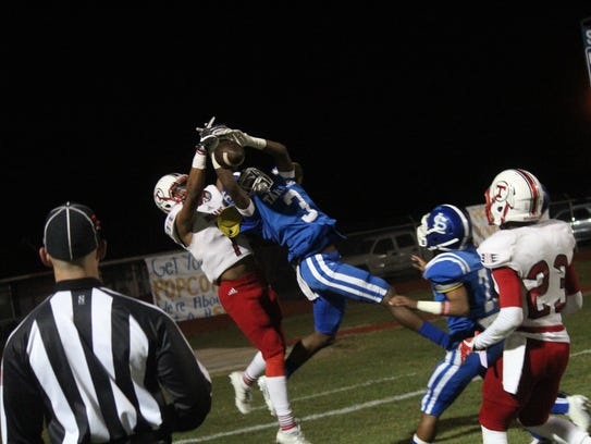 South Lafourche's Marquise Francis (3) breaks up a