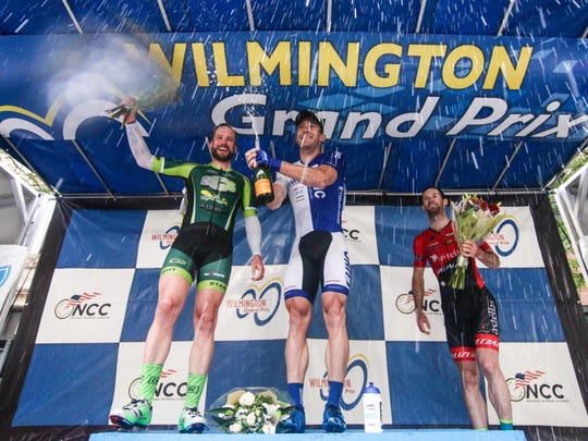 Brad White of team UnitedHealthcare Pro cycling celebrates Saturday after winning Wilmington's Men's Pro & Category I race for the third consecutive time.