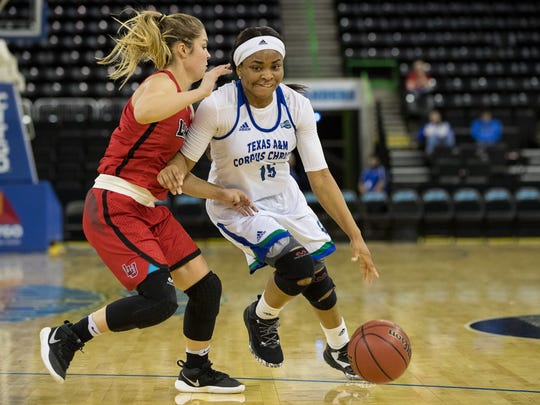 Texas A&M-Corpus Christi's Brittany Mbamalu drives the ball up the court during the second quarter of their game against Lamar at the American Bank Center on Saturday, Dec. 30, 2017.