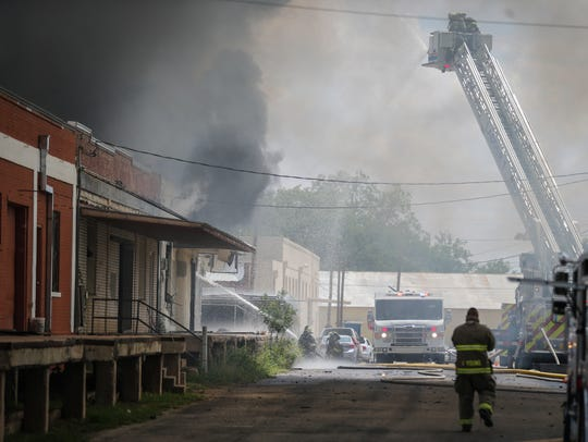 Firefighters battle a blaze Saturday, July 7, 2018,