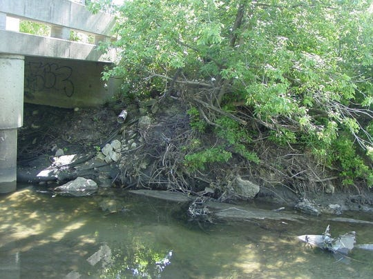 This before picture shows the erosion under the 73rd Street pedestrian bridge under the Clive Greenbelt.