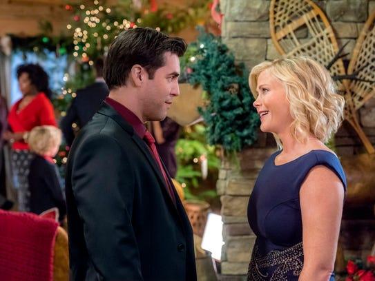 "Jordan Bridges and Alison Sweeney star in ""Christmas at Holly Lodge."""